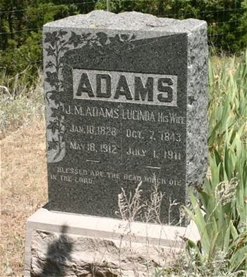 Gravestone of J.M. and Lucinda Adams.  Old Sun City Cemetery, Barber County, Kansas.   Photo by Kim Fowles.
